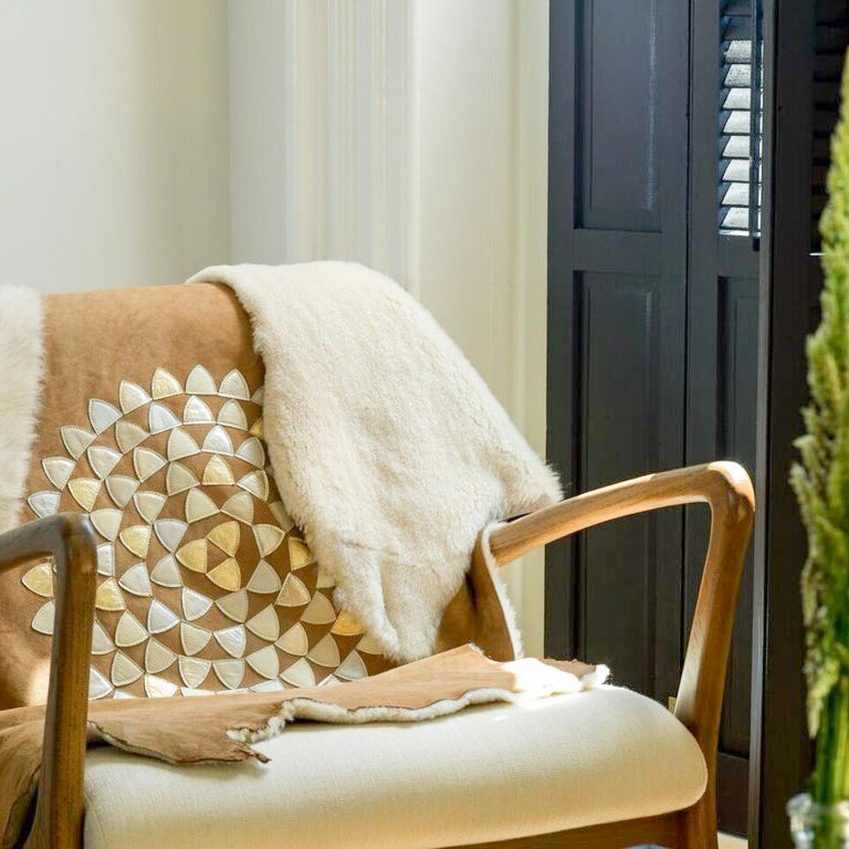 Shearling adorned with hand-punched and sewn metallic appliqué, this full sheepskin hide can be used as a throw, rug or decorative detail anywhere in your home.