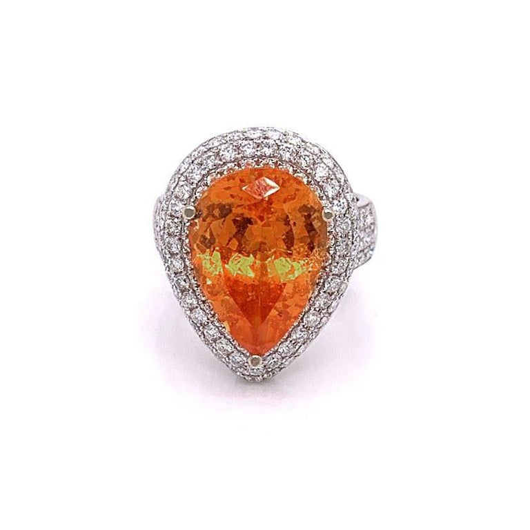 A special stone: weighting in at 10.35 carats and cut as a pear shape this mandarin garnet can be a collectors stone. It has a bright and vibrant orange color and free of any large inclusions that take away from the stone. It is accented and