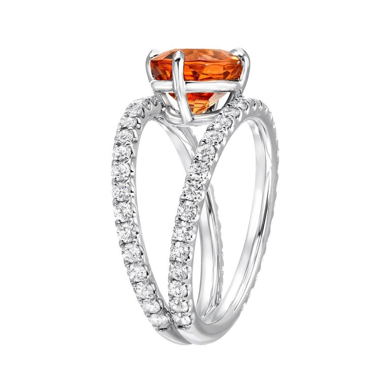 This vibrant 3.65 carat Mandarin Garnet oval, is set in an ultra fine double shank diamond platinum cocktail ring, created by Merkaba Jewelry. This Mandarin Garnet represents the finest of its kind globally, and is out of reach for the average