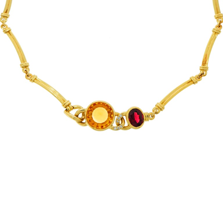 An exquisite Manfredi (Italy) design. Handcrafted in 18k Yellow Gold and featuring a Round Citrine and Oval Garnet with Diamond accent. Signed by Manfredi. Length of the necklace is 17 inches.
