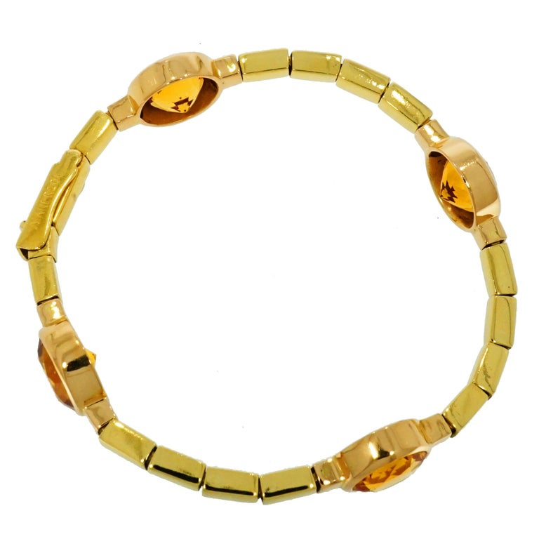 Gorgeous Bracelet!! Very clean and tailored design. Handcrafted in Italy by Manfredi in high polished 18k Yellow Gold straight links connecting four bezel set 12mm Round Citrine.  The Bracelet measures 7 inches. A must have in your collection ;)