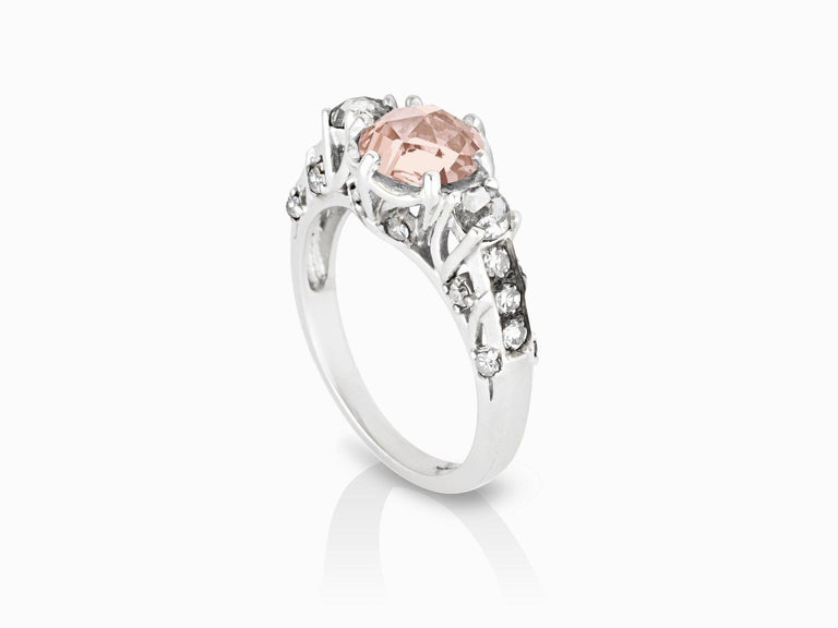 MANIAMANIA Ceremonial Engagement ring in 14k White Gold, with 7mm round Rose Cut Pink Tourmaline, two 3mm round rose cut rustic white diamonds (0.24 ctw), and accents and pavé of White Diamonds (0.5ctw).  Size 5. *This ring can also be hand made to