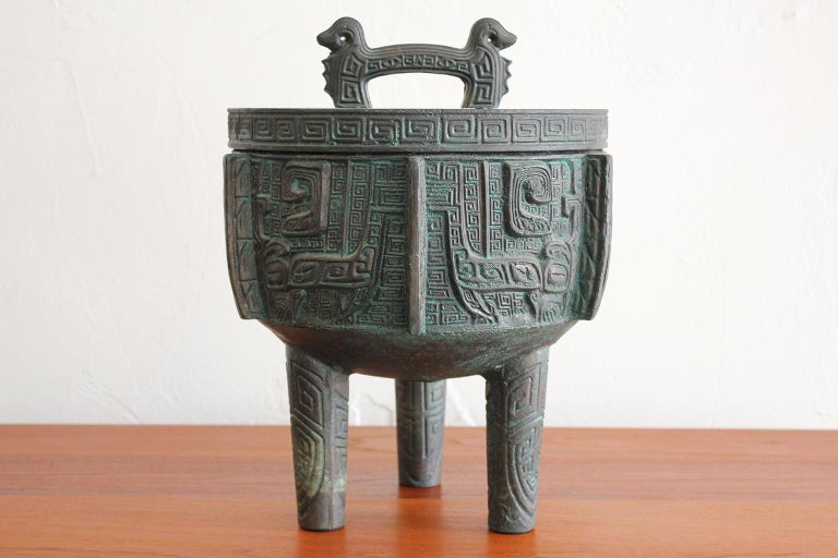 Great ice bucket in the manner of James Mont, circa 1960s. Has a Chinese/Asian design with a verdigris finish. Ice bucket is in excellent shape with very light use over the years. Measures: 13.5