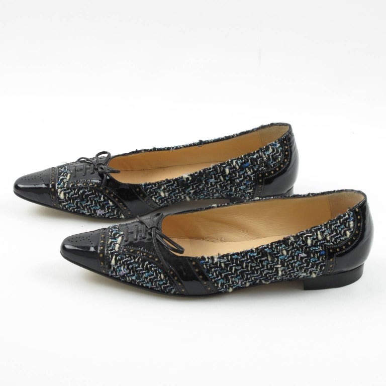 Manolo Blahnik simple and elegant flats shoes, size 37.5 (European), equivalent to 7.5 US. These Manolo Blahnik shoes are sure to become a great hit in your closet. The black patent leather is classic and adaptable and the elegant tweed fabric will
