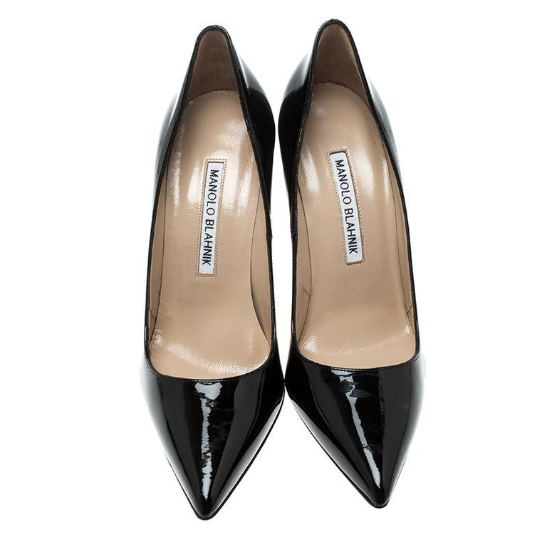 This pair of pumps by Manolo Blahnik is elegance personified. Dance around in this polished black pair. Feel special by slipping into this one luxuriously designed and lined with leather.  Includes: Original Box