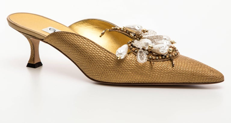 Manolo Blahnik, Circa 1998 Orientalia pale gold metallic lizard skin mules with faux pearls, beads and crystals.  IT. 39, US. 9  Orientalia mules were originally designed for Paloma Picasso in the 1980's. They were later released in different colors