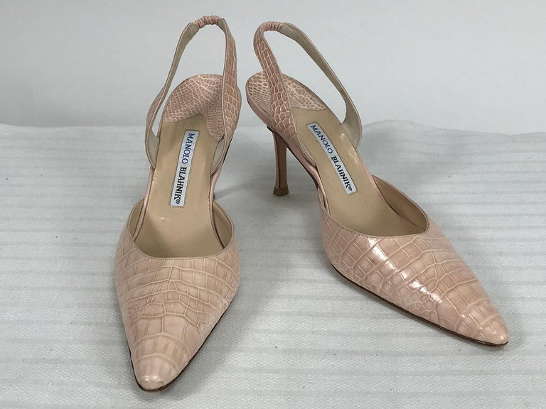 Manolo Blahnik pale pink alligator, sling back high heel pumps marked size 40. Pale sandy pink heels are in very good condition with little wear. Heels are 3 1/2