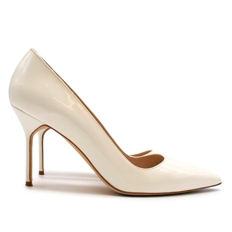 Manolo Blahnik Patent Leather Cream Pointed Toe Pumps   - Pointed toe  - Slip on  - 9.5cm heel  - no platform  - Patent Leather Outer  - Soft Leather insole  - light tan insole with branding   Made in Italy   Please note, these items are pre-owned