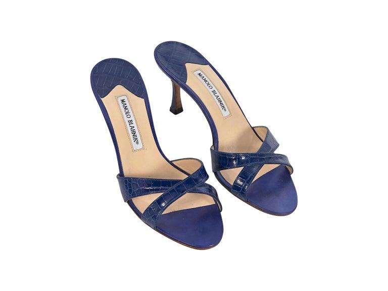 Product details:  Royal blue crocodile mule sandals by Manolo Blahnik.  Crisscross vamp.  Open toe.  Slip-on style.  2.5
