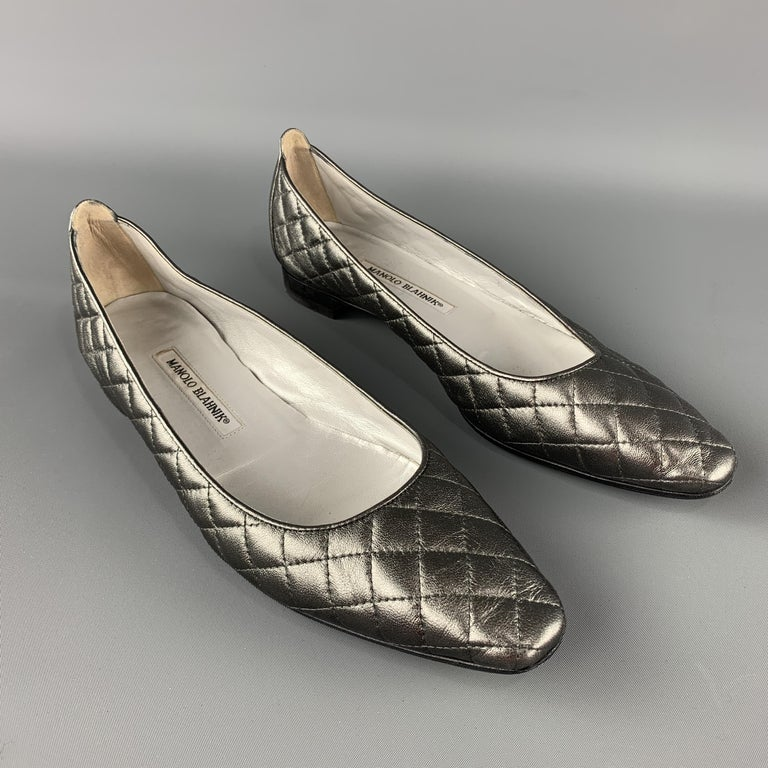 MANOLO BLAHNIK Giungla Flats comes in a grey tone in a quilted leather material, with a rounded toe, resoled.   Excellent Pre-Owned Condition. Marked: IT 40 1/2   Outsole: 11 x 3.5 in.