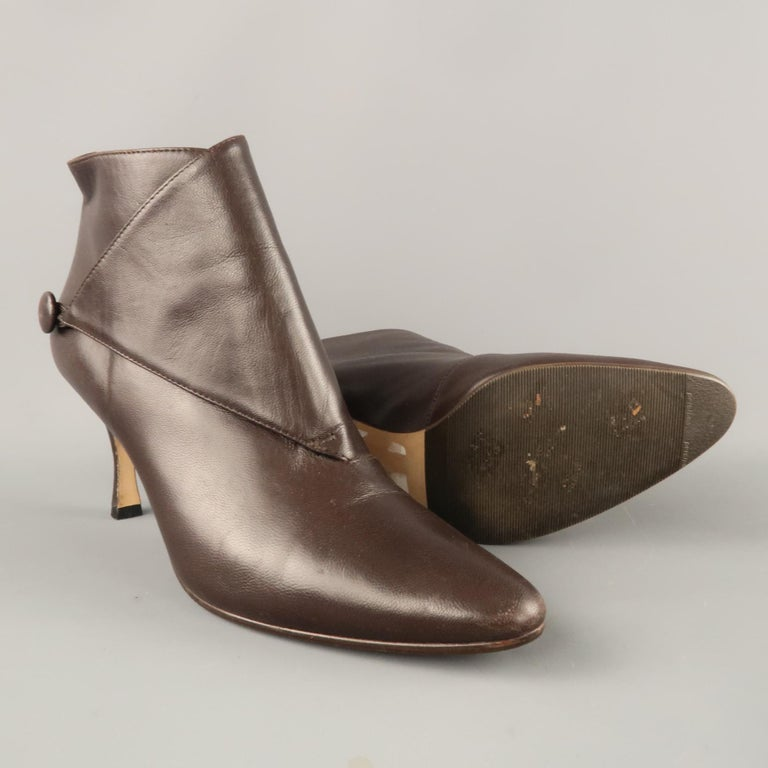 f47401ceb ... booties come in smooth brown leather with a pointed toe and. MANOLO  BLAHNIK