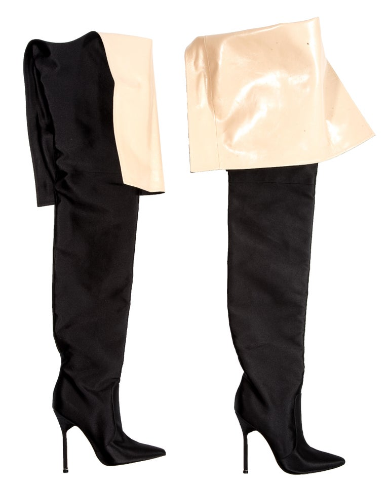 bc24d60d5b6 Manolo Blahnik x Vetements; black satin waist-high boots lined in cream  leather.