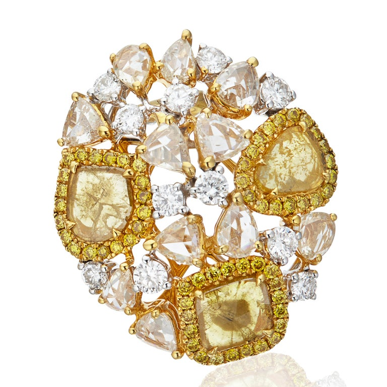 Gross weight: 12.840grams Gold weight : 11.700 grams  Diamond weight : 5.71 carats  Coloured slice diamonds and rose cut diamonds in 18k gold. Also available in white slice and rose cut diamonds in 18k white gold  Golden Cosmos Earrings by Manpriya