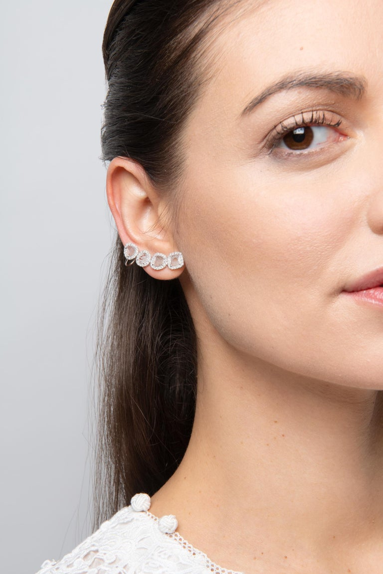 Gross Weight: 5.78 grams Gold Weight: 5.42 grams Diamond Weight: 1.81 carats  Four perfectly formed slice diamonds individually outlined in brilliant and round cut diamonds are linked together create a gentle curve.  For occasions when you need more