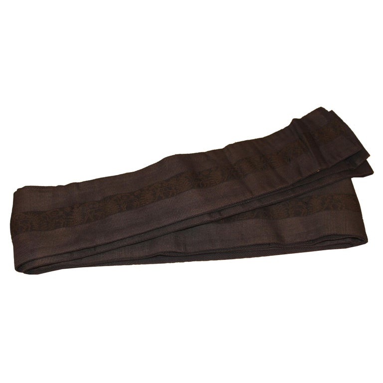 Handwoven and dyed men's silk obi was use as a belt to hold up a kimono. Use as a decorative runner on top of a chest or table. Taisho period, circa 1920s.