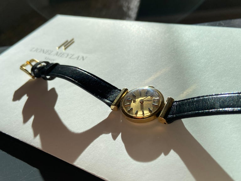 Vintage second hand Omega, ladies watch mechanical movement with manual winding, 20mm , 750 yellow gold , gold index dial, black leather strap, pin buckle Watch in good working order and aesthetics Estimated value CHF 3,500.–.