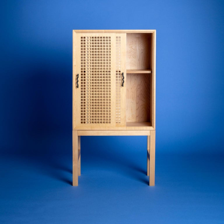 Prototyped in the weeks leading up to a solar eclipse, this bar cabinet is an exploration of partially obscured light. The laser cut lattice work on the bypass doors is an interpretation of the Mosharabi screens found in Moorish architecture.