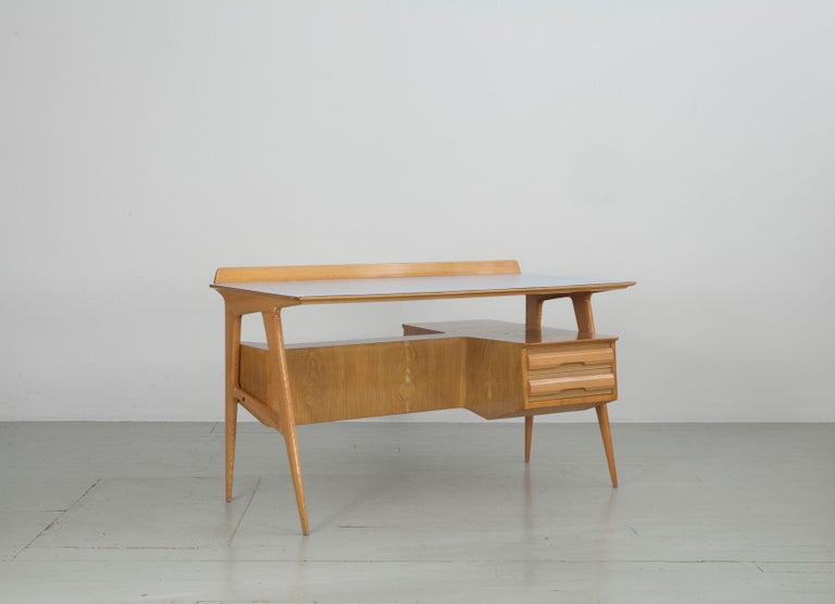 Italian writing desk with bookcase in maple wood with light blue table top finish. Ass. Arredamento Canturini Delmobile.  The chairs would fit to the desk 1stDibs Ref: LU2981323371542
