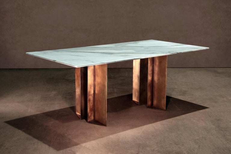 Marble and brass dining table handcrafted and signed by Novocastrian  Dining table in Calacatta Bourghini and patinated brass. A collaboration between novocastrian and architecture and interior design studio Lind and Almond. Handcrafted in North