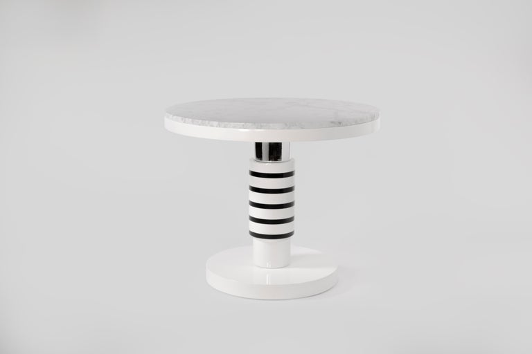 Marble andceramic large coffee table by Eric Willemart Materials: Top: Polished Carrara marble paate embedded in a White Lacquered   Wooden Tray  Body: Handcrafted ceramic glazed in black, white and silver finishes Base: White lacquered wood on