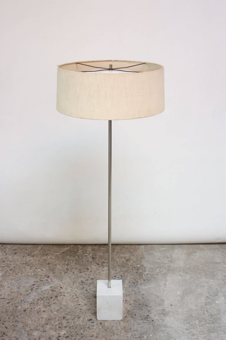Laurel floor lamp with square marble base and chromed-metal rod. Features three socket illumination, newly rewired and ready for immediate use. Includes period cylindrical shade with top and bottom diffusers for even distribution of light.