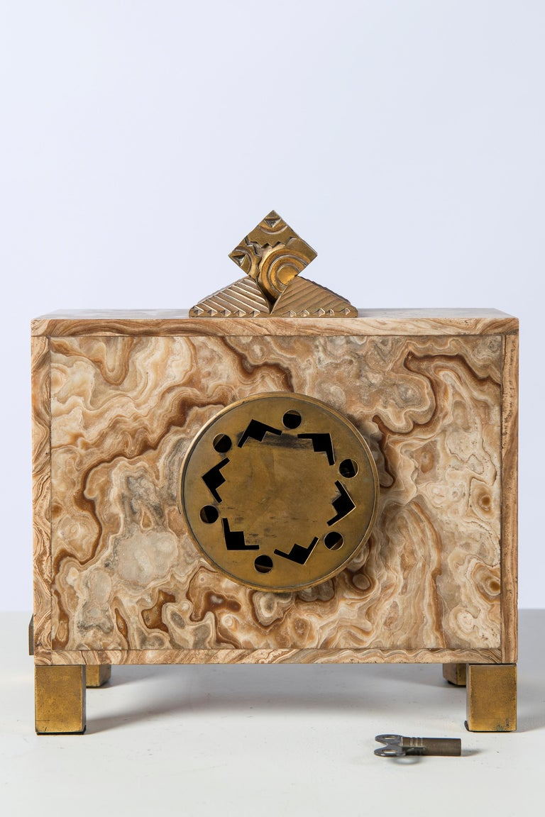 Marble and gilt bronze clock. Machine signed Bonnet and Pottier, France, 1920.