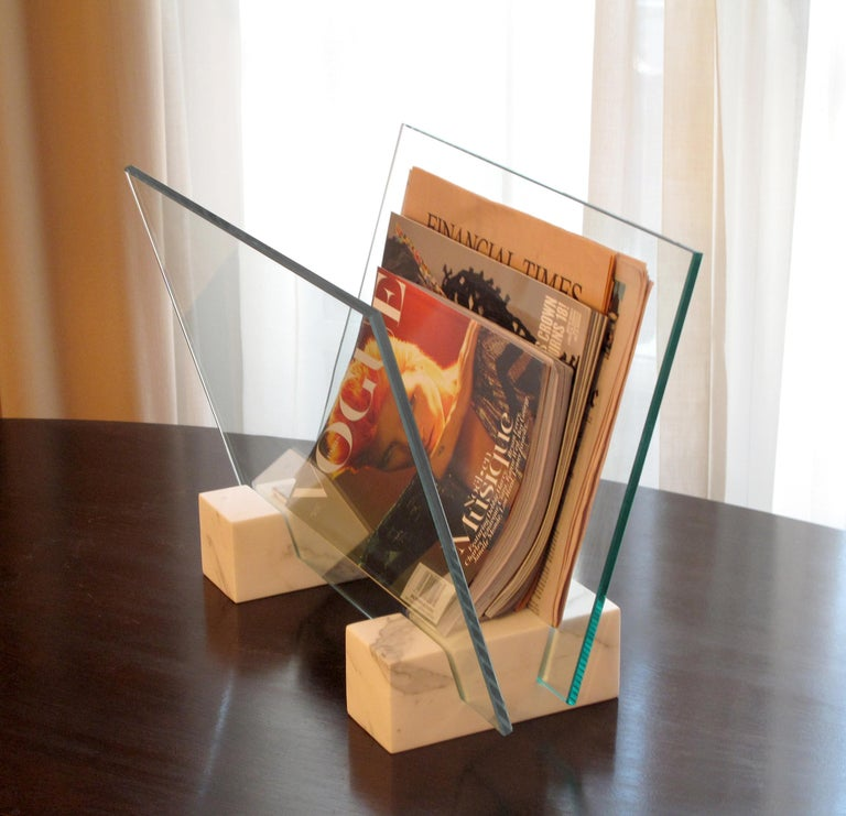 Storage stand for magazines and newspapers made from solid carved Carrara marble with glass panels.
