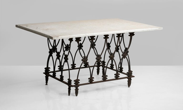 Marble and ornate iron garden table, America, 19th century.