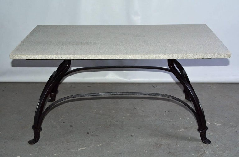 Indoor or outdoor metal base garden coffee table with grey-veined white marble married to a bronzed or black wrought iron base that is secured by gracefully neoclassical styled arched stretchers and end at the bottom by padded feet. Top and base can