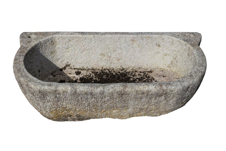 Mid-19th century solid marble bath. Used for washing horse's feet. To use as a planter, the bath would require drainage holes which can be carried out on site. Measures: 44 inches long.