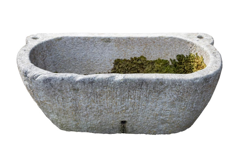 Mid-19th century solid marble bath, 46 inches long. Used for washing horse's feet. To use as a planter, the bath would require drainage holes which can be carried out on site