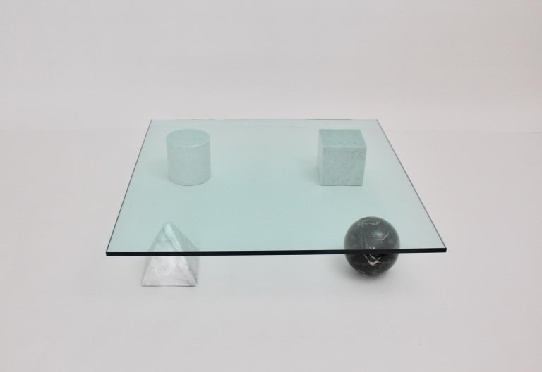 Massimo and Lella Vignelli vintage black and white marble coffee table or sofa table, which was designed 1979 Italy. The iconic coffee table or sofa table named Metaphora shows a base with four geometric polished marble elements in different marble