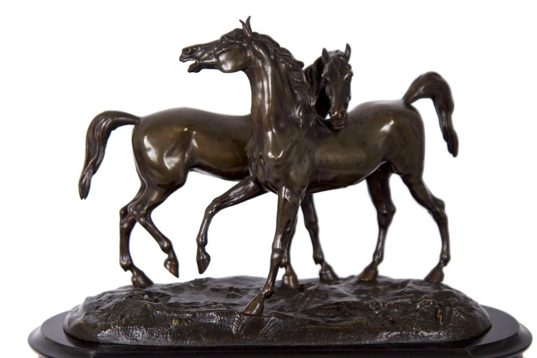 This playful figural clock is a fine representation of the Romantic idealizing that dominated the animal sculptors of the first half of the 19th century. While roughly correct anatomically in the modeling of the equestrian subjects, much more