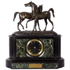 Marble and Black Slate Mantel Clock with Equestrian Sculpture Group, circa 1865