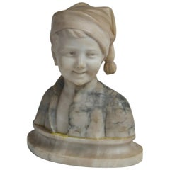 Marble Bust of a Boy with a Cap