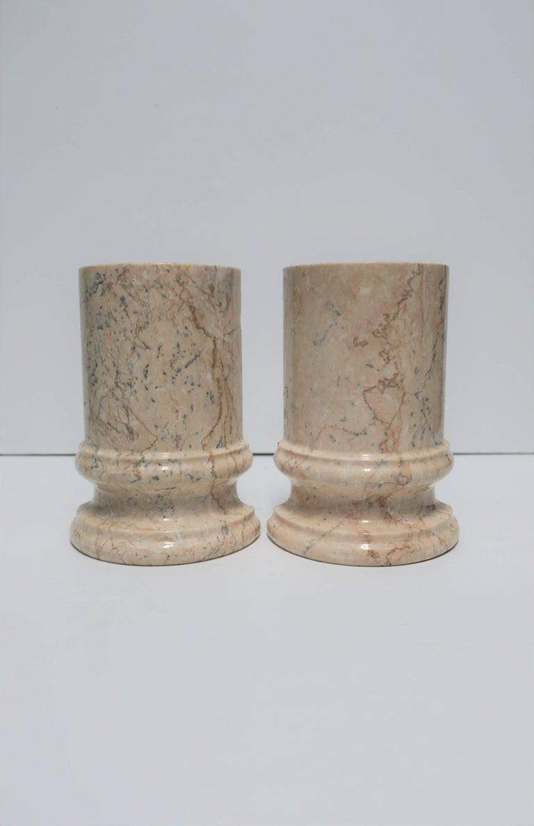 Pair of substantial vintage marble 'column' bookends in a predominantly tan or sand hue.   Each bookend measures: 5 in. W x 7 in. H