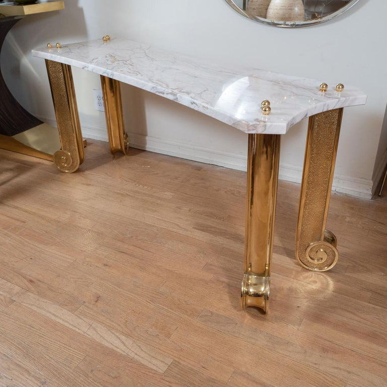 Marble console with brass fluted columnar legs.