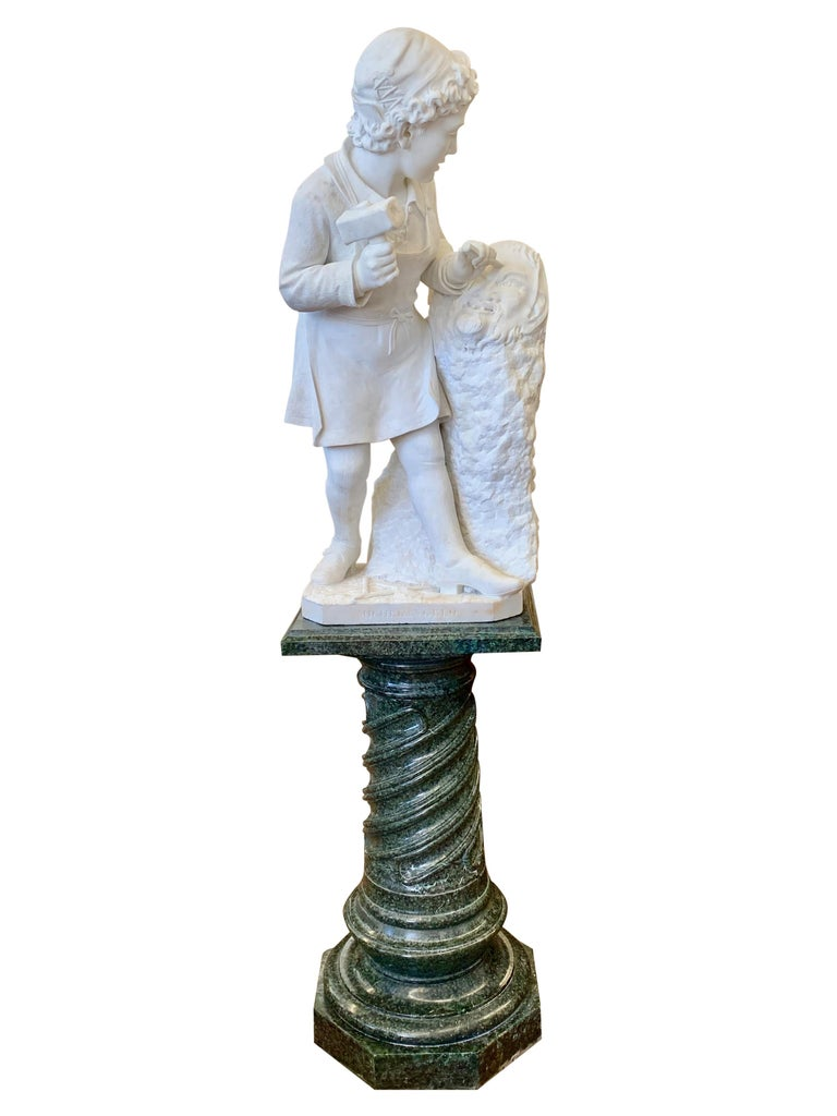 A museum quality 19th century Italian carved white Carrara marble figure of young Michelangelo carving the head of Faun by Pietro Bazzanti (1842-1881) The richly detailed Michelangelo standing holding a hammer and chisel while carving the head of