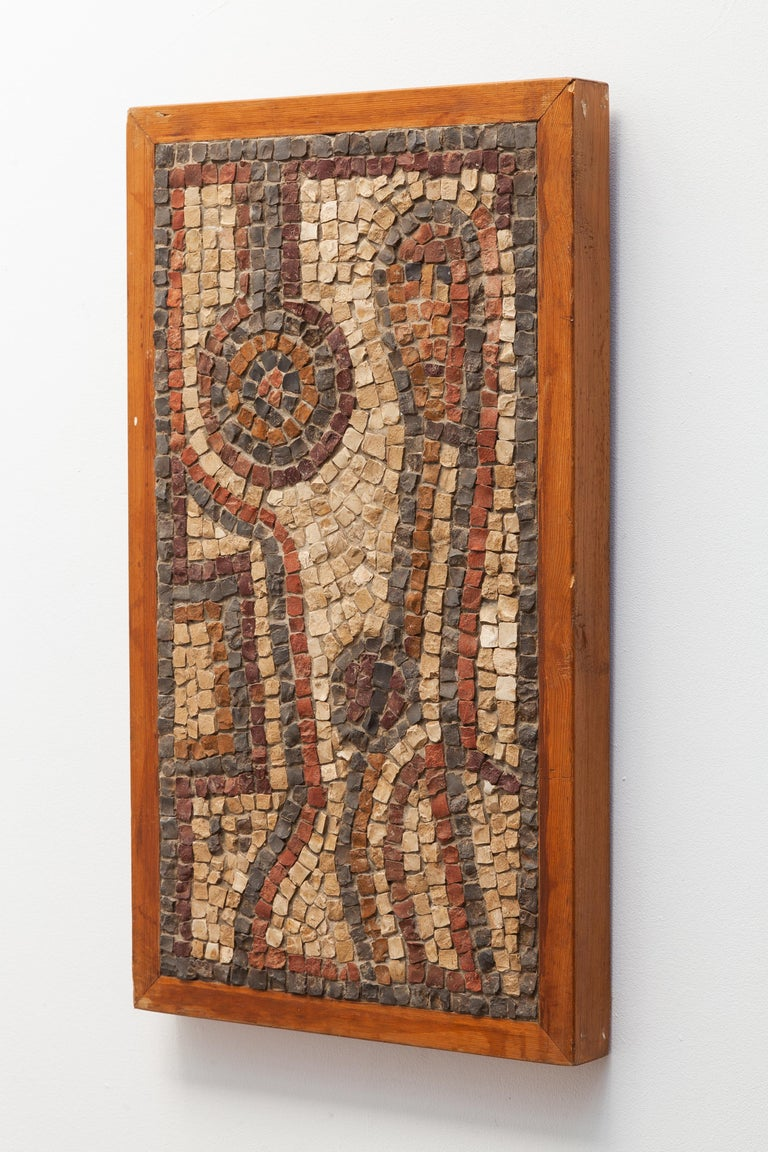 Mid-Century Modern mosaic tableau wall piece. Abstract design of a figure in mosaic marble, shades of browns and greys. Sturdy wooden frame.