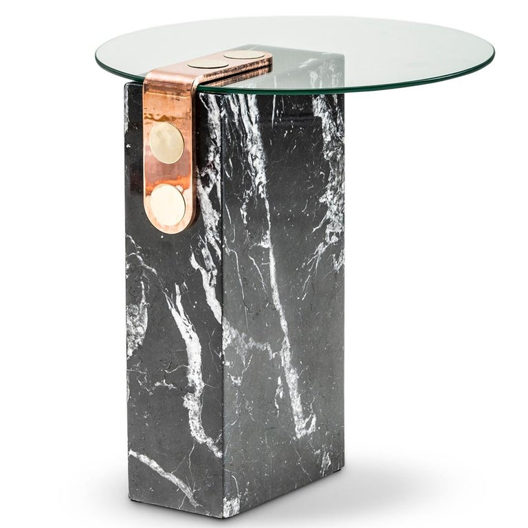 The marble patch side table is part of the Patch collection by Egg Designs. Patch makes reference to the brass fixing mechanism which was design by Egg Designs and is used on many of their furniture pieces. The side table has a base of marble with a