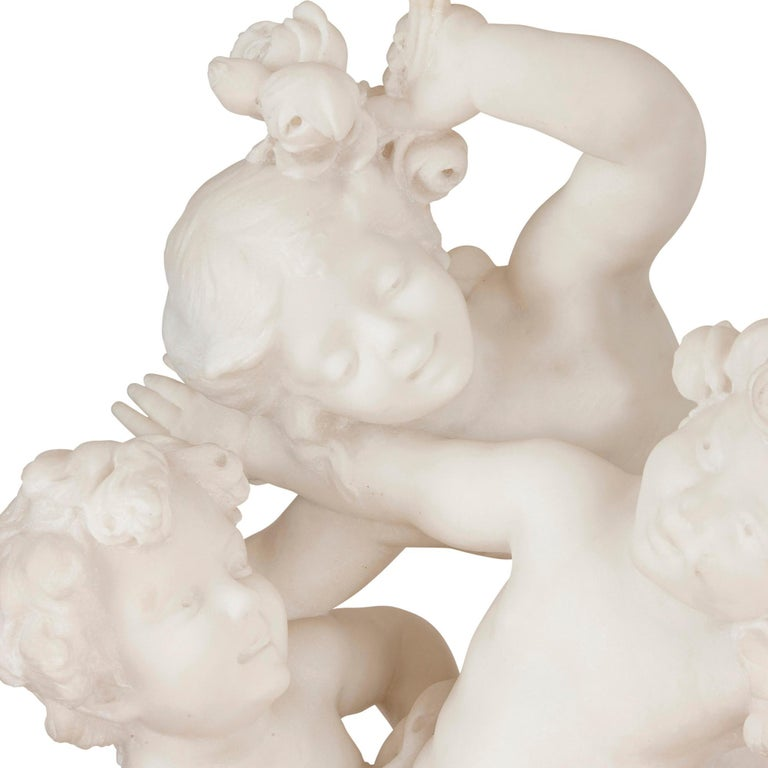 Marble Group of Putti Battling over Flowers by Charles Raphaël Peyre In Good Condition For Sale In London, GB