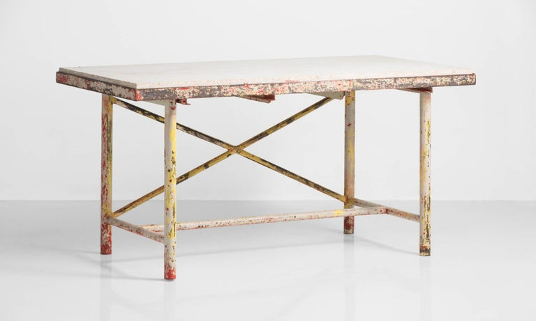 Marble laboratory table, France, circa 1920.  An incredible marble slab sits on an Industrial iron base with beautifully worn original paint.