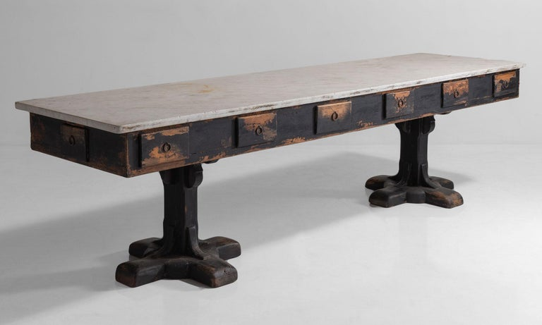 Slab marble-top on painted wooden base. Drawers on both sides with original iron hardware.