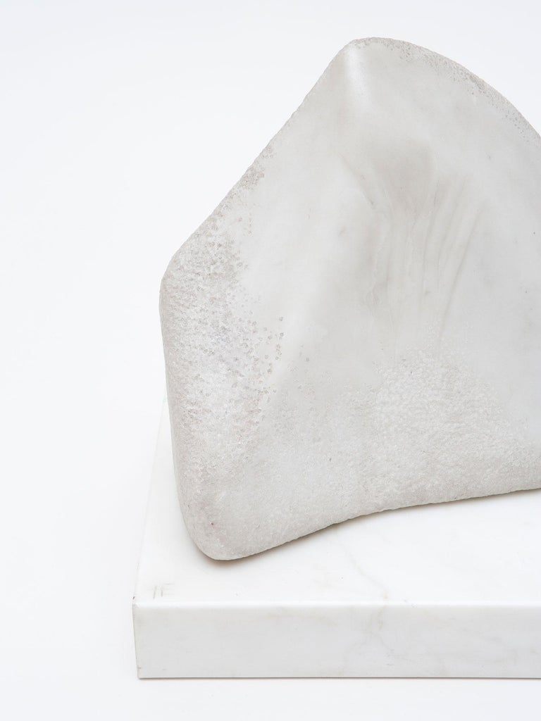 White Statuario Marble sculpture by Israeli-American artist Hanna Eshel (b. 1926). Hand carved in Carrara, Italy. Eshel is a multi-disciplinary artist best known for her work in carved marble, a skill she honed from 1972-1978 while living and