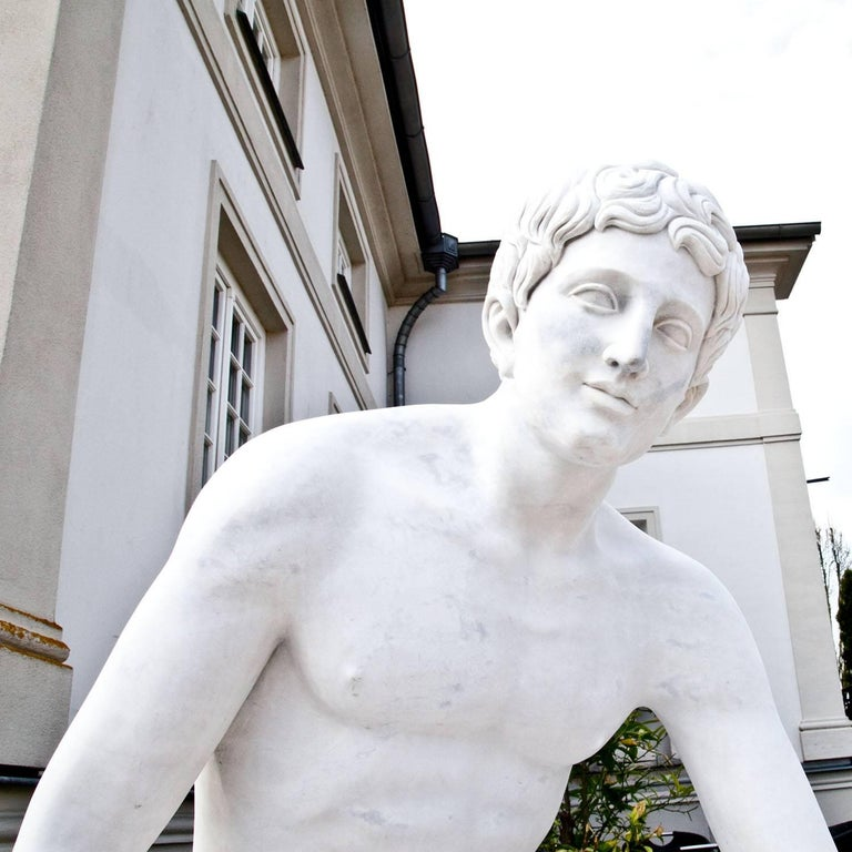 Life-sized marble sculpture of the so called 'Resting Hermes' by Lysippos. The sculpture was hand-carved out of white marble and has a fine surface.
