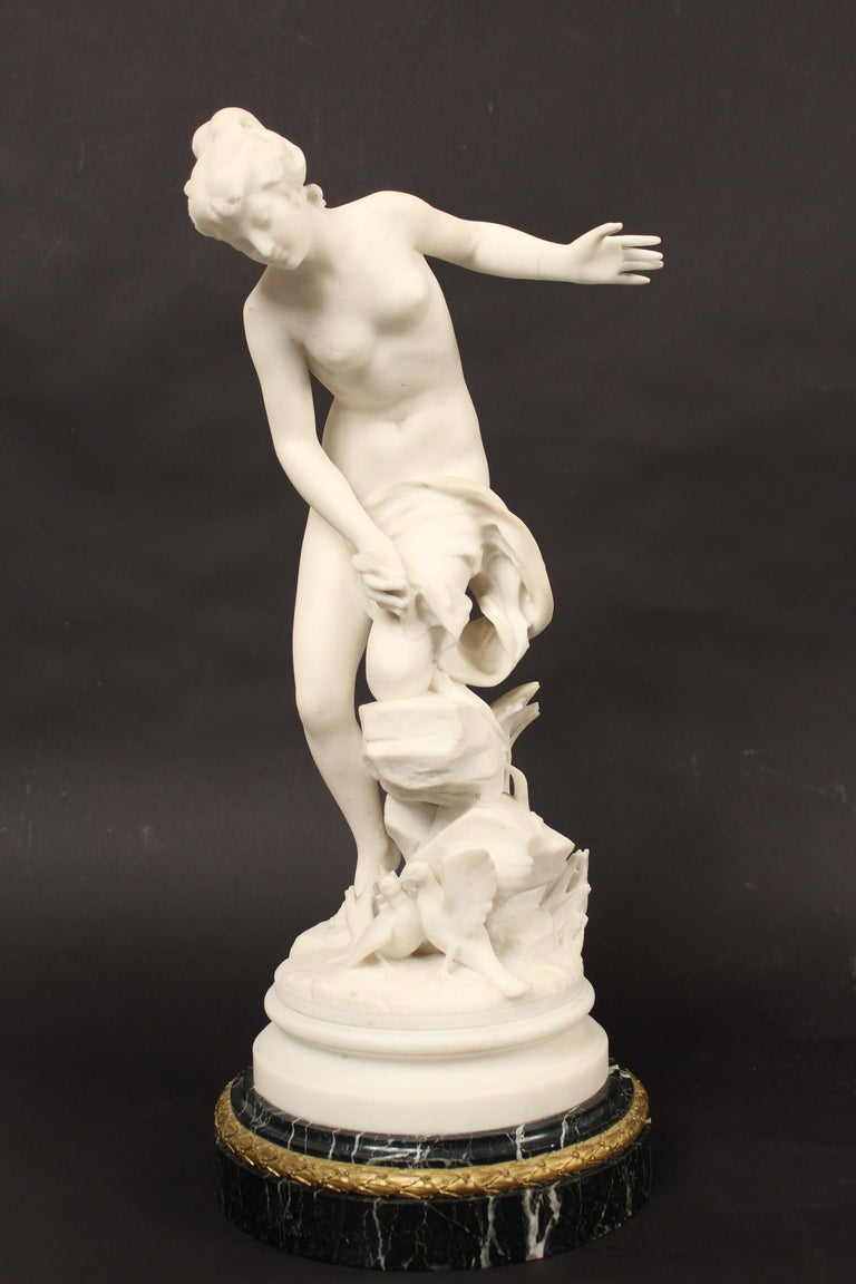 Marble statue of a lady with 2 doves resting on a green marble with an ormolu band, signed Rene Bulens, circa 1900. The height of 23