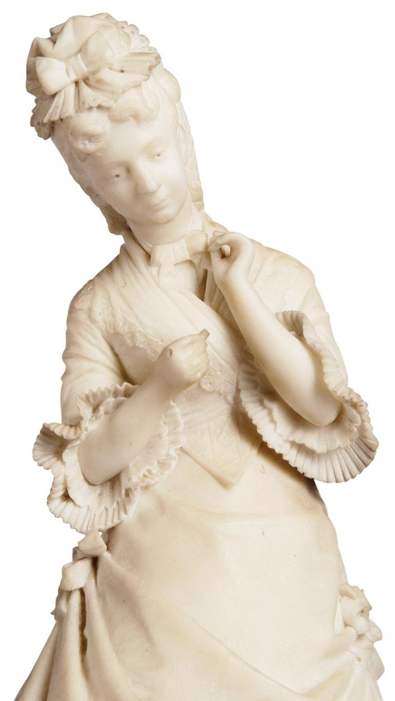 A good quality 19th century marble statue of a young girl wearing a bonnet, resting against a stool. Inscribed; Elena Varese - E. Ximenes Ettore Ximenes was widely known as a specialist in official monuments. A graduate of the Accademia di Belle