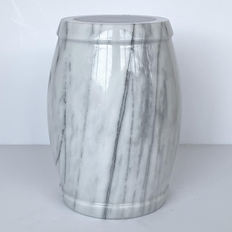 A unique marble stool or side table. White marble with gray veining. Top is inset with a round 7