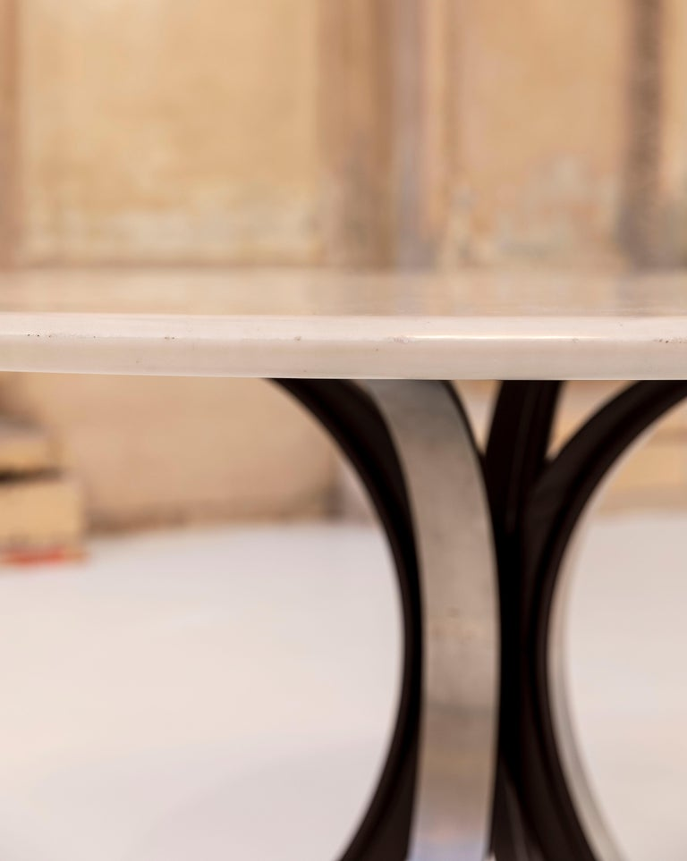 Stunning white Carrara marble-top and with the four famous metal saber feet.