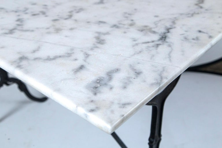 Marble Top Cast Iron Bistro Table, France, early 20th century. Carrara marble top on black iron base.
